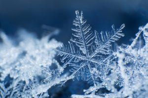 snowflake on blue background data operations blog